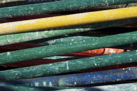 forefront of work piled up struts and assorted colors photo