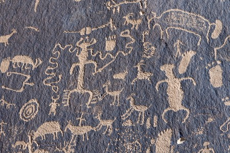 native american art: Indian petroglyph in Newspaper Rock, Utah