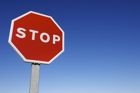stop sign: forefront of a stop sign with a clear blue sky