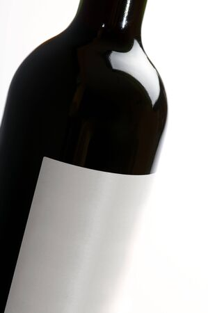 foreground of a black bottle of wine with white background Stock Photo - 7895852