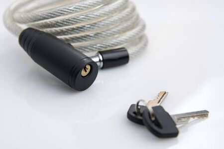 quandary: forefront of a security padlock and two keys