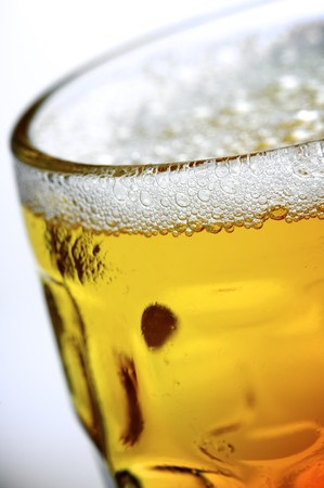 foreground of a refreshing pitcher of beer photo