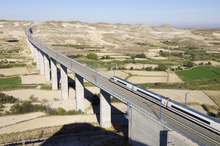 rail travel: view of a high-speed train crossing a viaduct in Spain Stock Photo