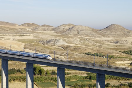 viaduct: view of a high-speed train crossing a viaduct in Spain Editorial