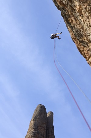 descending: climber descending with the technique of rappelling in Riglos mountains Stock Photo