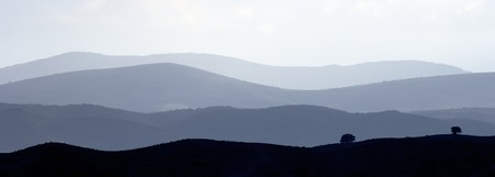 landscape of hills through the fog in spain photo