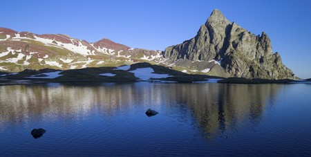 Anayet peak reflected on a lake in the Pyrenees, Spain