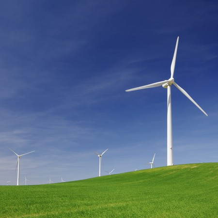windmills for electric power production in an idyllic meadow Stock Photo - 8257035