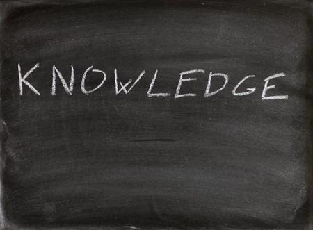 the word knowledge written in chalk on a blackboard photo