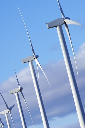 windmills group with blue and cloudy sky Stock Photo - 8334793