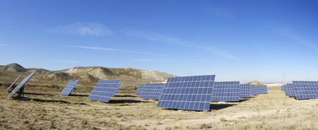 Panoramic view of a solar field to power production photo