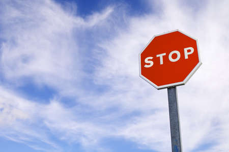 forefront of a stop sign with a cloudy sky Stock Photo - 8334947