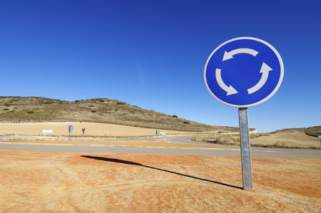 roundabout: view of a roundabout signal with blue sky Stock Photo