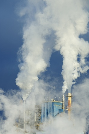 acid rain: smoke produced by the smokestacks of a paper mill Stock Photo
