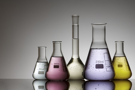 scientifical: group of laboratory flasks containing liquid color