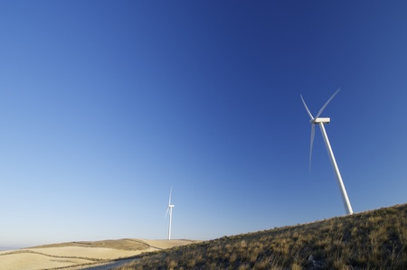 modern windmills for electricity production and grassland Stock Photo - 8444714