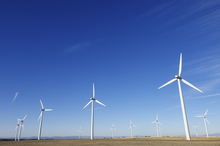 group of aligned windmills for electric power generation alternative Stock Photo - 8485830