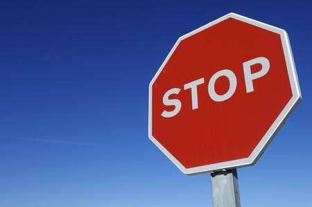 forefront: forefront of a stop sign with a clear blue sky