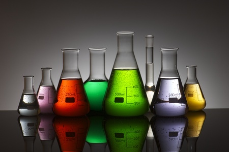 experiment: group of laboratory flasks containing liquid color