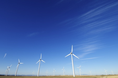 group of aligned windmills for electric power generation alternative Stock Photo - 8679023