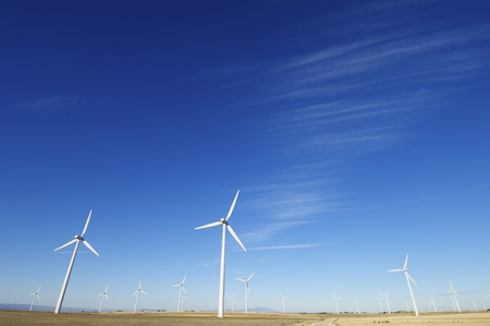 group of aligned windmills for electric power generation alternative Stock Photo - 8679024