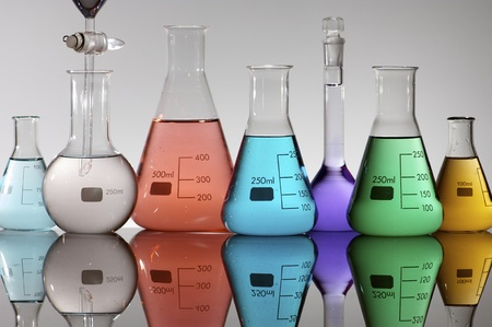 forefront of a laboratory flasks containing brightly colored liquid Stock Photo - 8731459