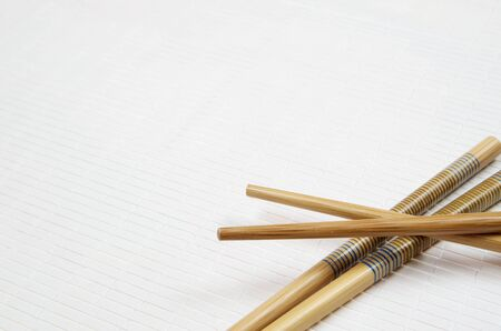 forefront: forefront of  China food sticks on a  white tablecloth