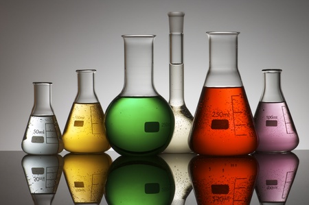 yellow yellow lab: group of laboratory flasks containing liquid color