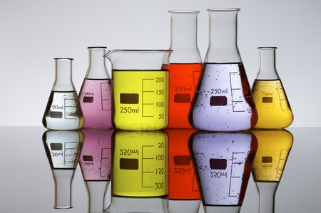 brightly: group of laboratory flasks brightly colored liquid Stock Photo