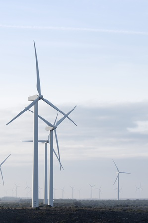 windmills for electricity production with cloudy sky Stock Photo - 8731514