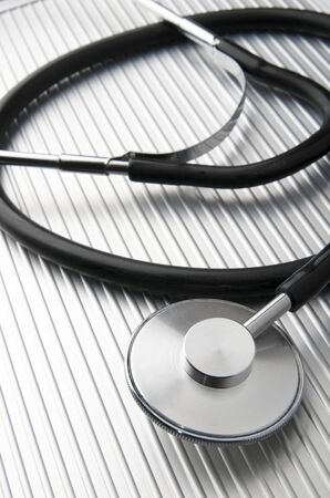 closeup of a  stethoscope on a metal surface photo