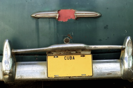 rickety: closeup of a rickety  old car in the city of Trinidad, Cuba