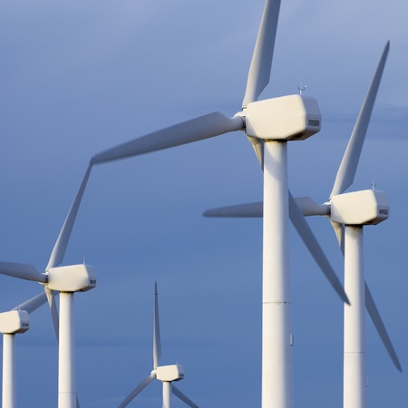 wind mill: windmills group for energy production with cloudy sky