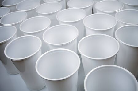 plastic cup: large group of white disposable plastic cups Stock Photo