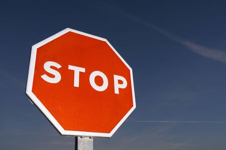 forefront of a stop sign with a blue sky at sunset Stock Photo - 8983474