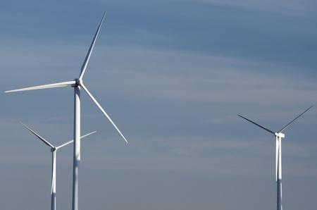 view of two  windmills for renewable electric  energy production photo