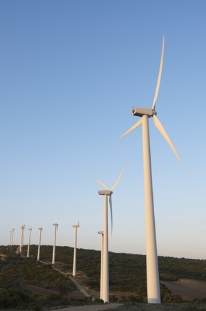 lined up: windmills lined up at dusk Stock Photo