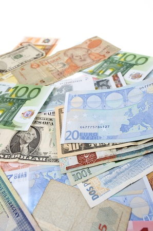 group banknotes of different countries around the world photo