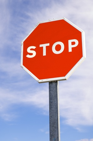 forefront of a stop sign with a cloudy sky Stock Photo - 10046064