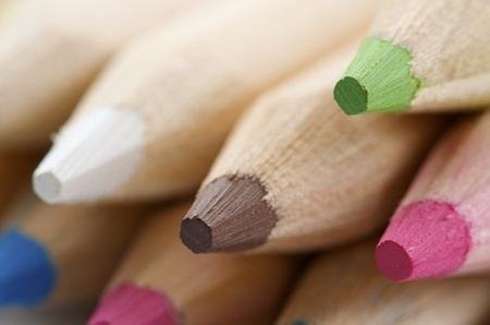 red pencil: forefront of  a group of colored pencils stacked