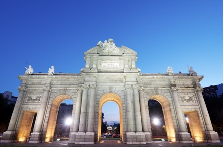 night view of the  famous Puerta de Alcala, Madrid, Spain photo