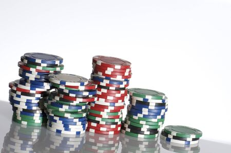 casino chips  stacked on a white table Stock Photo - 10387681