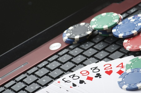 view of casino chips and cards to gamble and play online photo