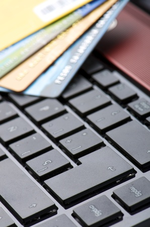 credit cards and a computer for online shopping photo
