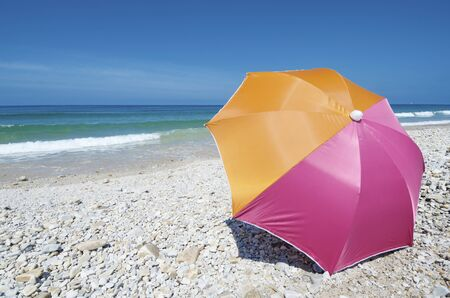 cantabrian: Umbrella on the beach of San Antolin, Cantabrian Sea,  Llanes, Asturias, Spain