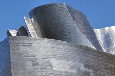 Bilbao, Biscay, Basque Country, Spain, July 30, 2011: foreground view of the titanium facade of the  Guggenheim Museum. Guggenheim Museum is dedicated  exhibition of modern art and was  designed by architect Frank Gehry. Stock Photo - 10558480
