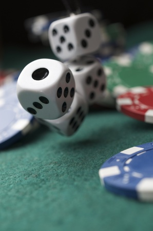 roll of the dice on a game table in a casino photo
