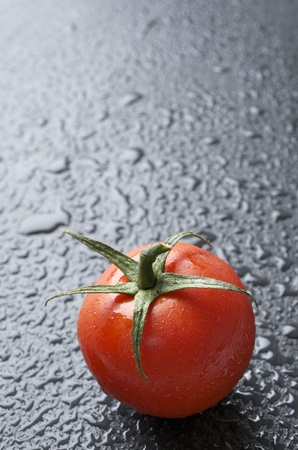 forefront: forefront of a fresh tomato on a  slate table Stock Photo