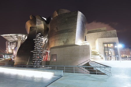 frank gehry: Bilbao, Biscay, Basque Country, Spain, July 30, 2011: night view of the  Guggenheim Museum at sunset. Guggenheim Museum is dedicated  exhibition of modern art  and was  designed by architect Frank Gehry. Editorial