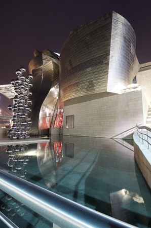 Bilbao, Biscay, Basque Country, Spain, July 30, 2011: night view of the  Guggenheim Museum at sunset. Guggenheim Museum is dedicated  exhibition of modern art  and was  designed by architect Frank Gehry.